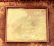 Textured Frame. Wooden Frame against stone background. Ideal for customizing with text. Can be used to display a menu, address and other info. Rich texture, aged Stock Photo