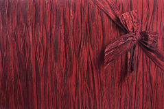 Textured Gift Background - Horizontal. Crimson red fabric textured gift background with a bow tied in the upper right corner, diagonally Royalty Free Stock Photos