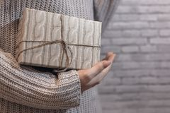 Textured gift in hands stock image