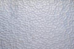 Textured glass 2. Textured light glass background closeup stock photo