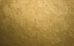 Gold background. Textured gold background, decorative surface Royalty Free Stock Photography
