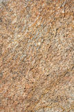 Textured Granite Background. A background composed of iron rich granite rock useful as a texture or backdrop Royalty Free Stock Photo