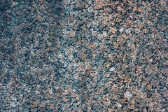 Textured granite wall Stock Images
