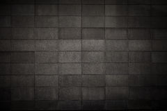 Textured grunge concrete grid background. Grunge background with a tiled grid pattern Royalty Free Stock Images