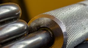 Textured handles on a hand grip trainer close up. Close up of steel and grips of a manufactured item Royalty Free Stock Photography