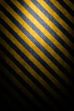 Textured hazard background. With Black and yellow angled lines Stock Photo