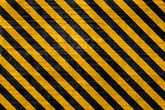Textured hazard background. Textured hazard construction background with Black and yellow angled lines Royalty Free Stock Photography