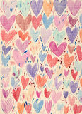 Textured Hearts Background. Lots of colorful sketchy hearts drawn on a canvas textured paper, looking like a textile print Stock Images
