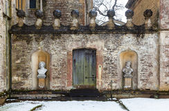 Textured historic wall with snow at Rousham House, Oxfordshire Stock Image
