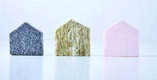 Textured house shapes on white background. Blue, green and pink textured house shapes isolated on a white background royalty free stock image