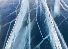 Textured ice blue frozen lake winter background Stock Photography