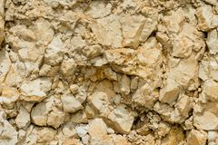 Textured kamienny tło gruzu balast w naturalnej formie w rockowej ścianie zdjęcie stock