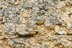 Textured kamienny tło gruzu balast w naturalnej formie w rockowej ścianie fotografia stock