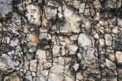 Textured kamienny tło gruzu balast w naturalnej formie w rockowej ścianie fotografia royalty free