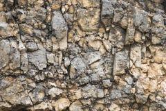 Textured kamienny tło gruzu balast w naturalnej formie w rockowej ścianie zdjęcia stock