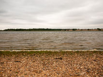 Textured Layers of a Sea Shore Overcast and Waves, sand and Pebb. Les; Essex; UK Royalty Free Stock Photography