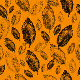 Textured leaves on an orange background, seamless pattern Royalty Free Stock Image