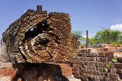Textured log and bricks at abandoned gold mine. Textured old wood and bricks at old abandoned gold mine at Ravenswood, Queensland, Australia stock images