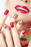 Textured manicure. Textured manicure with yellow and green dots royalty free stock image