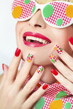 Textured manicure . Textured manicure with yellow and green dots and glasses stock image