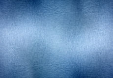 Textured Metal Background. A textured metal background with highlights, brushed patterns and a blue tint Royalty Free Stock Photos