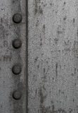 Textured Metal with Bolts. A Close up of the side of a metal tank stock photo