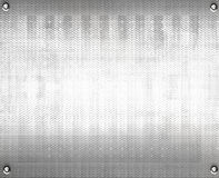 Textured metal sheet. Rectangle of shiny, textured metal sheet, with fixing screws in each corner Stock Image