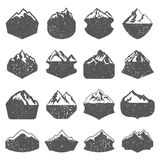 Textured Mountain Shapes. Set of sixteen textured vector mountain shapes. Camping mountain badges, travel labels, climbing or hiking badges