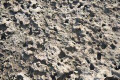 Textured natural stone background. Coarse textured natural gray stone background closeup Royalty Free Stock Photography