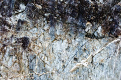 Textured natural stone background. Textured natural stone - rock background Royalty Free Stock Image