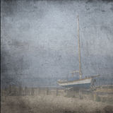 Textured old grange paper background with blue sail yacht Royalty Free Stock Photo