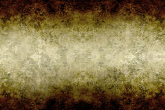 Textured old grungy paper. In shades of brown Royalty Free Stock Photo