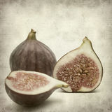 Textured old paper background. With ripe purple bursa figs fruit Royalty Free Stock Images
