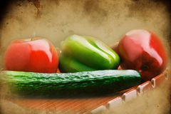 Textured old paper background with apple, pepper and cucumber Royalty Free Stock Photography