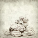 Textured old paper background. With beans Stock Photography