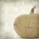 Textured old paper background. With carved pumpkin stock illustration