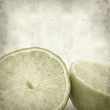 Textured old paper background. With cut lime fruit Stock Photography
