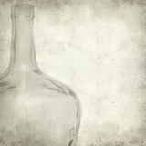 Textured old paper background. With old glass bottle Royalty Free Stock Photo
