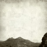 Textured old paper background. With ladscape of Gran Canaria, Cruz Grande stock image