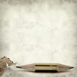 Textured old paper background. With very short pencil sharpened at both ends Royalty Free Stock Image