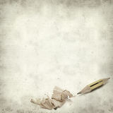 Textured old paper background. With very short pencil sharpened at both ends Royalty Free Stock Photo
