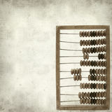 Textured old paper background. With wooden abacus Royalty Free Stock Photography