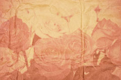 Textured old paper with vintage roses in double exposure Stock Images