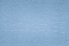 Textured paper background with blue surface effects Royalty Free Stock Image