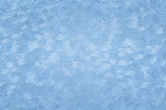 Textured paper background with blue surface effects Stock Image