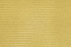Textured paper background with gold surface effects Stock Image