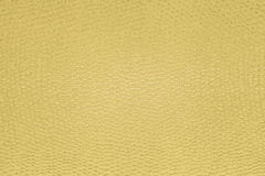 Textured paper background with gold surface effects Stock Photography