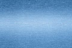 Textured papierowy tło z błękitnymi nawierzchniowymi skutkami zdjęcie royalty free