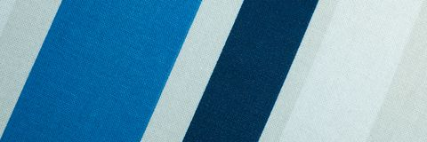 Textured with a pattern of diagonal strips of white and shades of blue stock photos