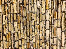 Textured pattern of an old stone yellow brick road. In Mediterranean style stock image